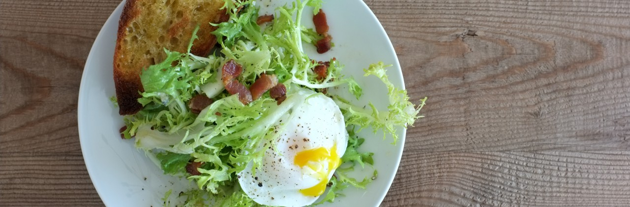 Frisee Salad with Bacon and Poached Eggs