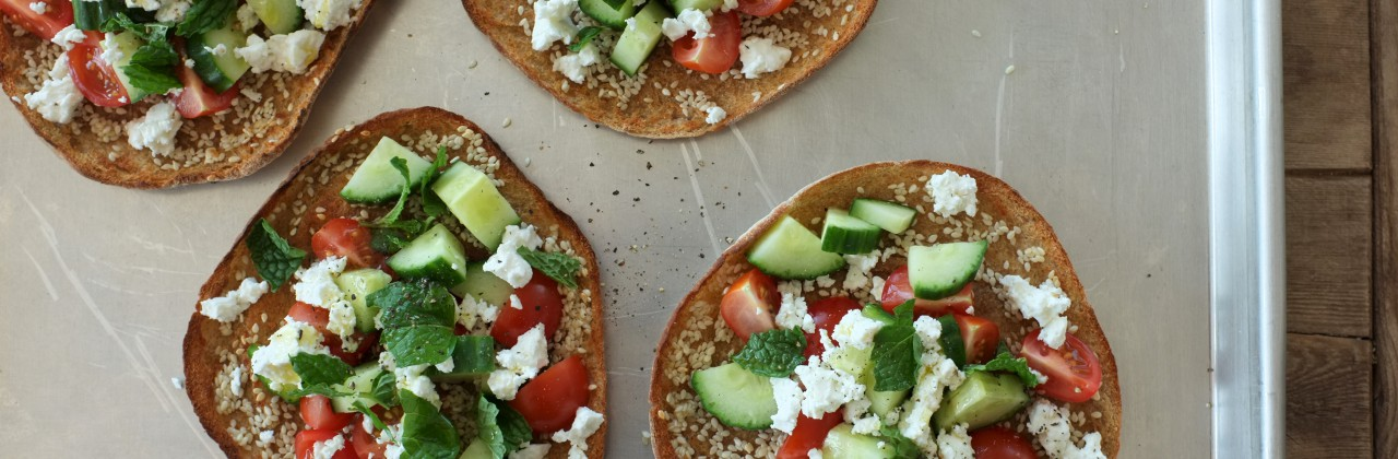 Sesame Broiled Pitas with Tomatoes, Cucumber, Mint & Feta