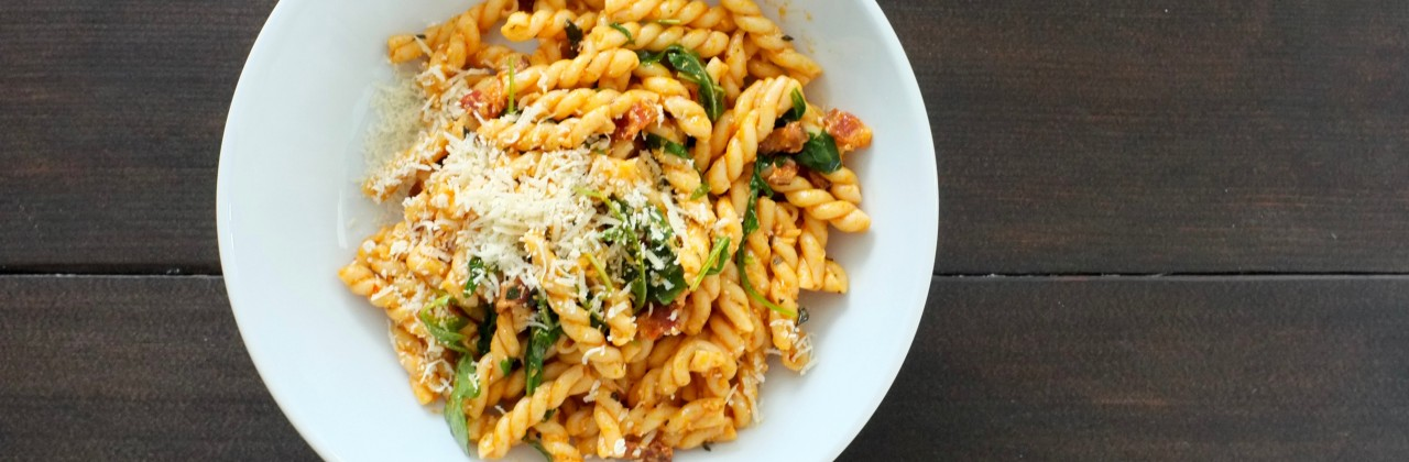 Tomato Pasta with Bacon and Arugula