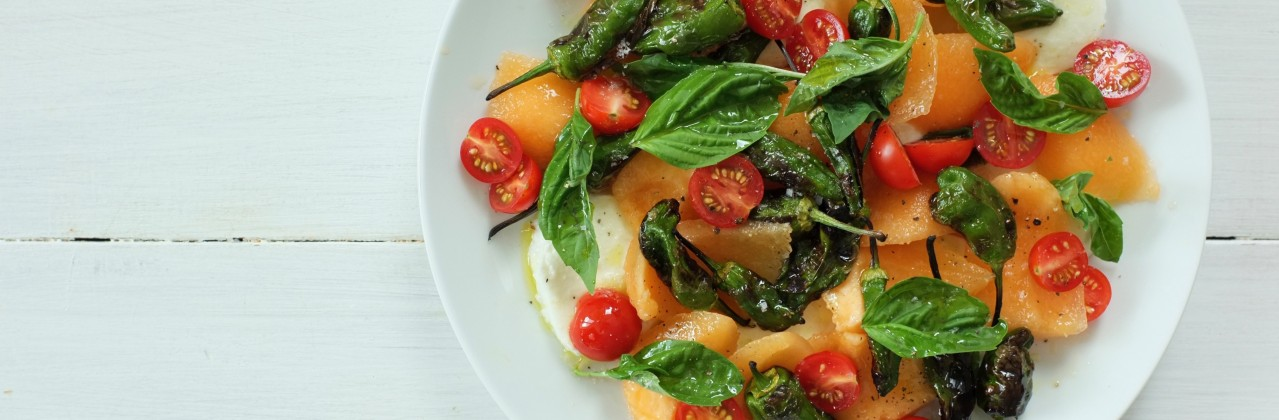Tomato Mozzarella Salad with Cantaloupe and Charred Shishitos